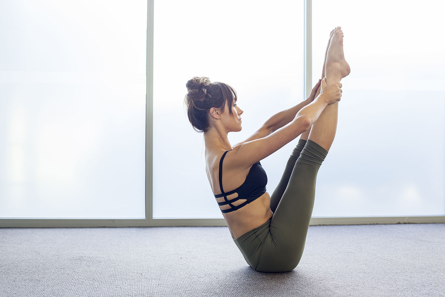 Pilates instructor in difficult pose